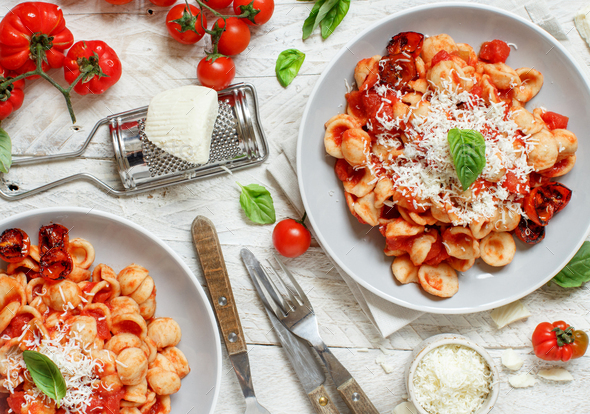 South italian  pasta orecchiette with tomato sauce and cacioricotta cheese - Stock Photo - Images