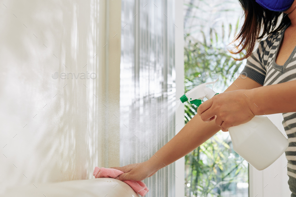 Woman cleaning white leather sofa - Stock Photo - Images
