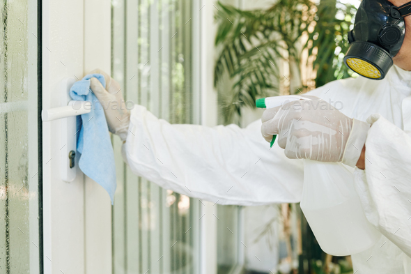 Disinfecting door handle - Stock Photo - Images