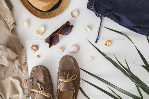 Male hipster fashion accessories on white. Flat lay, vacation and travel items - Stock Photo - Images