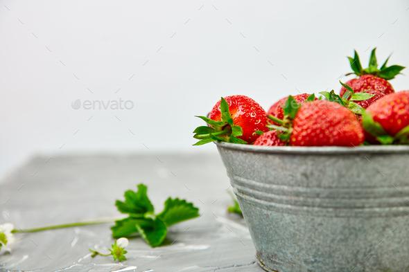 Strawberries in grey bowl. Fresh strawberries. Beautiful strawberries. - Stock Photo - Images