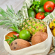 Fresh vegetables and fruits in eco cotton bags on table in the kitchen. - PhotoDune Item for Sale