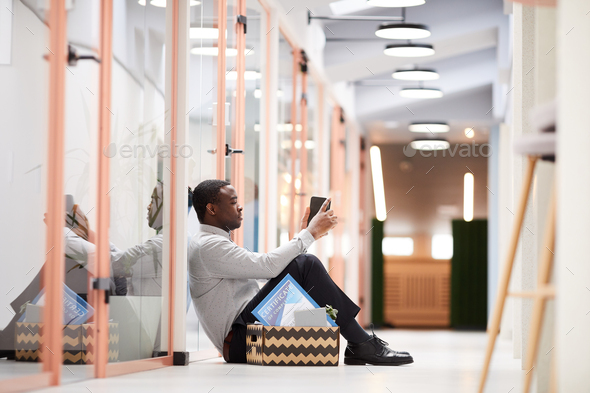 Fired African Man Waiting Outside Office - Stock Photo - Images