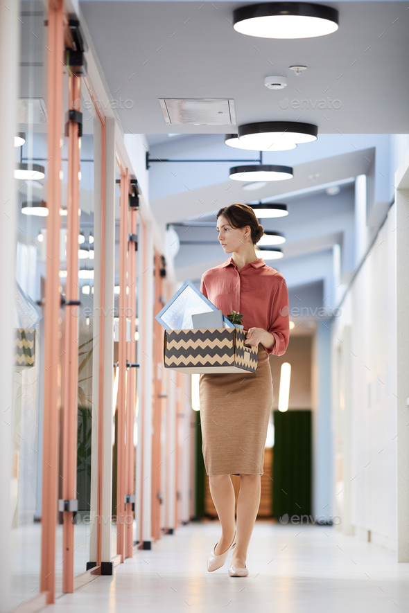 Young Businesswoman Leaving Work - Stock Photo - Images