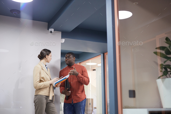 Two Business People Talking in Modern Office Interior - Stock Photo - Images