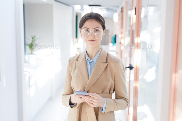Elegant Young Businesswoman in Office Hall - Stock Photo - Images
