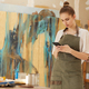 Female Artist Using Smartphone in Studio - PhotoDune Item for Sale