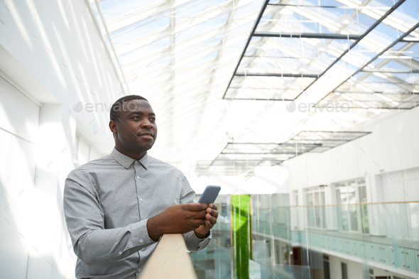 Contemporary African-American Businessman Holding Smartphone - Stock Photo - Images