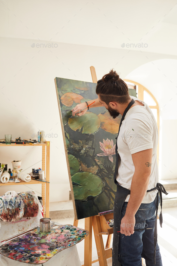 Modern Bearded Man Painting on Easel in Studio - Stock Photo - Images