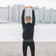Sport. Young woman girl in sports clothes doing stretching exercises city on the river side. - PhotoDune Item for Sale