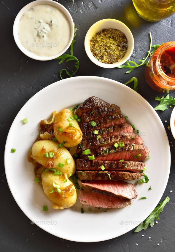 Sliced medium rare roast beef with potato - Stock Photo - Images