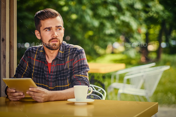 A man using laptop in a cafe. - Stock Photo - Images