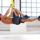 Sporty male exercising with fitness trx straps. - PhotoDune Item for Sale