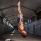 Man hanging upside down on gimnastic rings. - PhotoDune Item for Sale