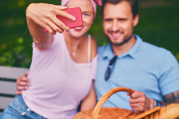 A couple using smartphone and instant messaging. - Stock Photo - Images