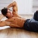 Male doing stomach exercising on a floor. - PhotoDune Item for Sale