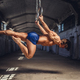 Athletic gymnast exercising on stationary rings. - PhotoDune Item for Sale