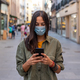 Woman on the street with mask and phone - PhotoDune Item for Sale