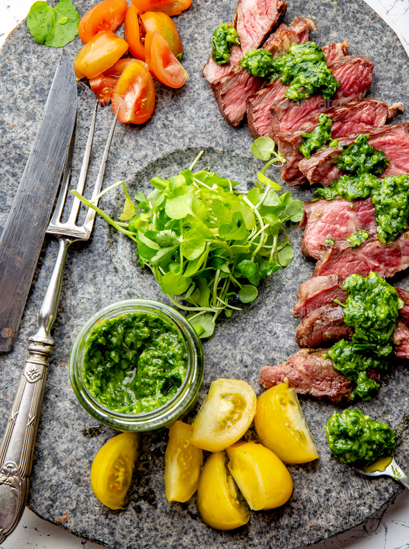 Juicy steak medium rare beef with spices and salad - Stock Photo - Images