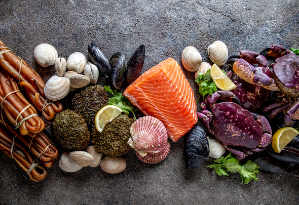 Pacific seafood background. Fresh salmon, crabs ostions clams mussels, seaweed - Stock Photo - Images
