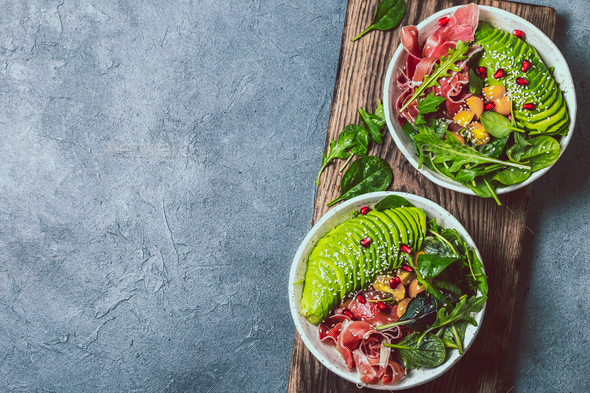 Low carbs bowl. Fresh salad with green spinach, rucola, avocado and ham serrano - Stock Photo - Images
