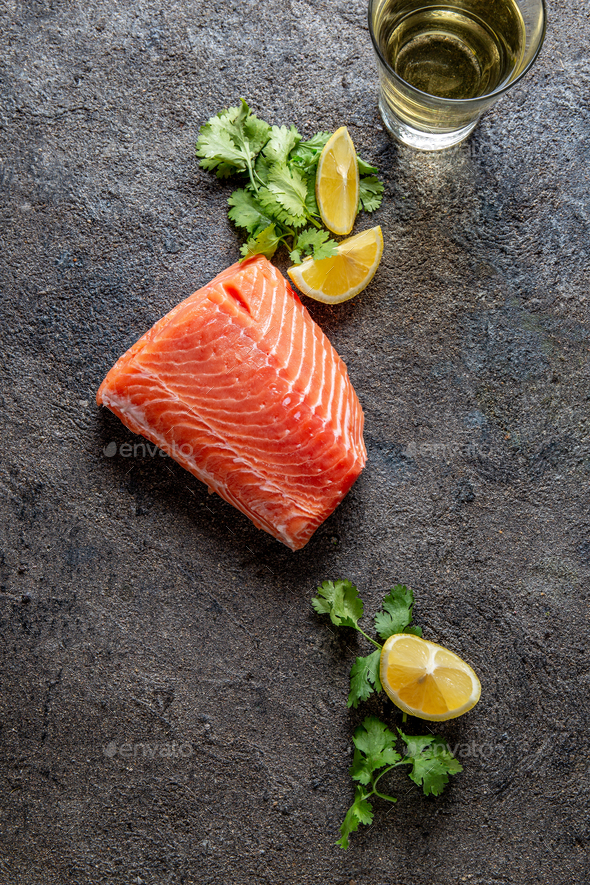 Fresh salmon with spices and lemon - Stock Photo - Images