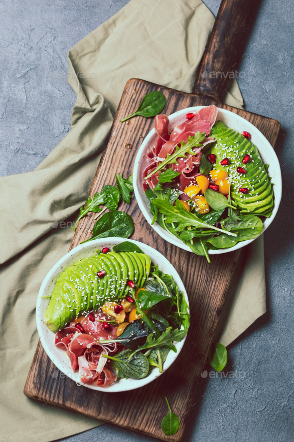 Low carbs bowl. Fresh salad with green spinach, rucola, avocado an ham serrano - Stock Photo - Images