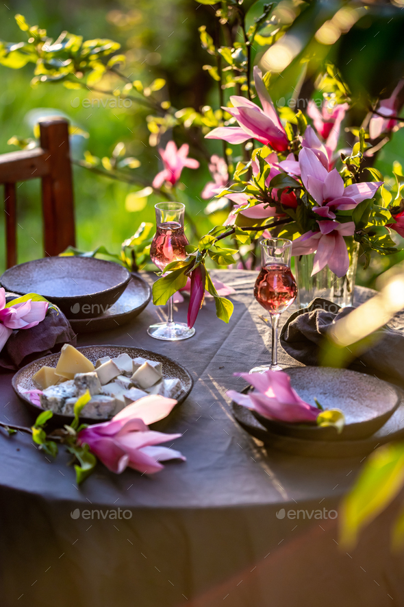 Beautiful table setting in garden on sunset light - Stock Photo - Images