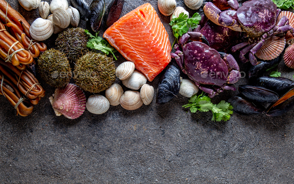 Fresh salmon, crabs ostions clams mussels, seaweed cochayuyo, sea urchins. - Stock Photo - Images