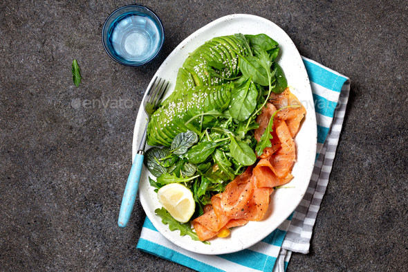Smoked salmon with mixed lettuce, avocado, arrugula - Stock Photo - Images