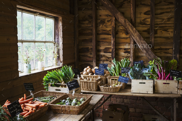 Tables of organic produce in a farm shop. - Stock Photo - Images