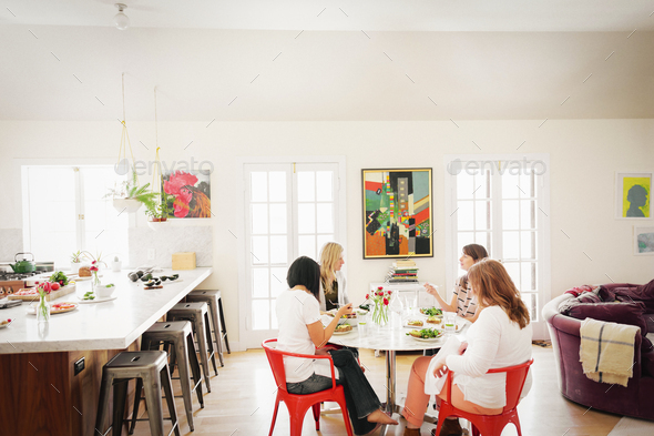 Four women friends having lunch. - Stock Photo - Images