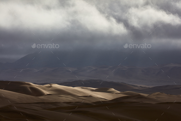 Sand dunes under a stormy sky. - Stock Photo - Images