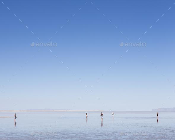 Group of people standing on flooded Bonneville Salt Flats, Utah - Stock Photo - Images