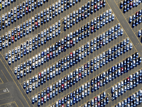 Aerial view of a car distribution centre, new cars parked in rows on a lot ready for sale. - Stock Photo - Images