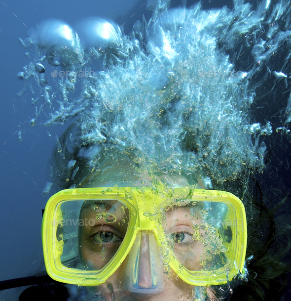 Close up of teenager's face while scuba diving. - Stock Photo - Images