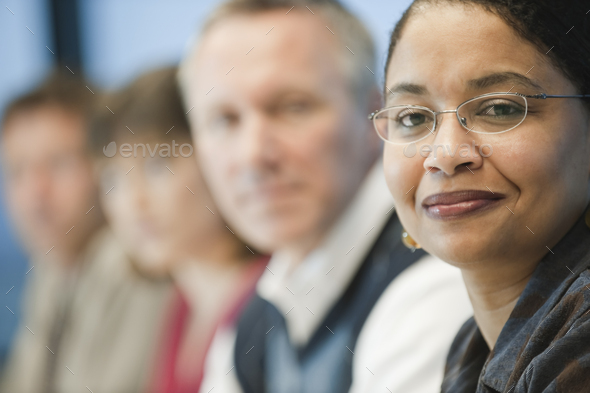 Mixed race team of business people led by a black businesswoman. - Stock Photo - Images
