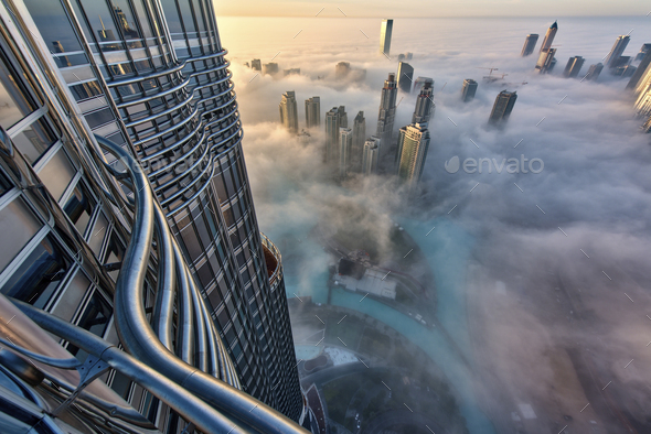 Aerial view of cityscape with skyscrapers above the clouds in Dubai, United Arab Emirates. - Stock Photo - Images
