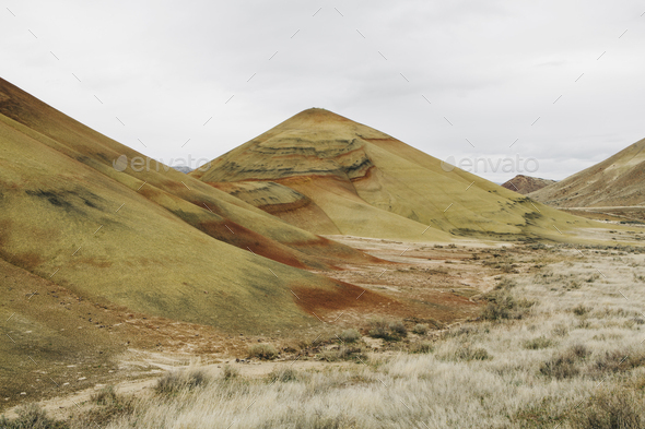 The Painted Hills desert and landscape, coloured layered geological strata in the John Day Fossil - Stock Photo - Images