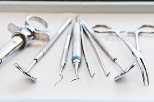 Closeup of medical tools on a tray in a dental surgery. - Stock Photo - Images