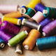 Bobbins of wound thread, silks and cottons in bright colours. - PhotoDune Item for Sale