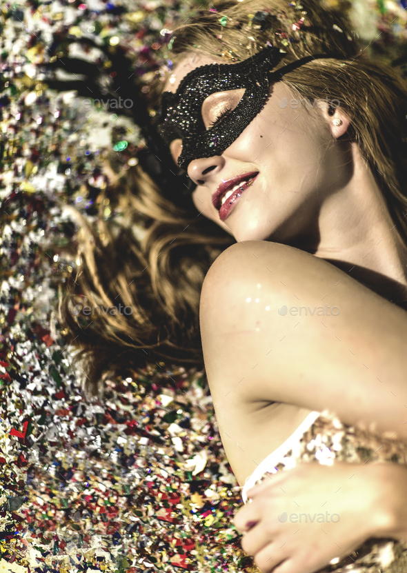 A young woman with long blonde hair at a glitter party, with falling confetti. - Stock Photo - Images