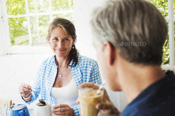 A woman and making talking over a cup of tea. - Stock Photo - Images