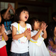 Group of children, girls and boys singing and clapping together in a temple. - PhotoDune Item for Sale