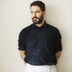 Half length portrait of a bearded man wearing a white apron. - PhotoDune Item for Sale