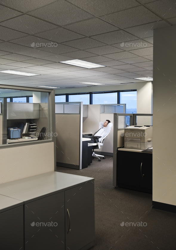 Businessman working in cubicle office. - Stock Photo - Images