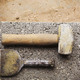 Close up of a hammer and chisel on a concrete slab. - PhotoDune Item for Sale