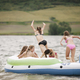 Teenage girls in an inflatable dinghy on a lake. - PhotoDune Item for Sale