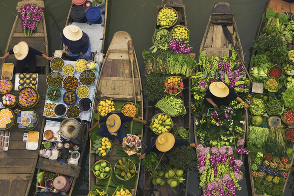 Aerial view of a floating market on a canal in Bangkok, local boats laden with fresh food, moored - Stock Photo - Images