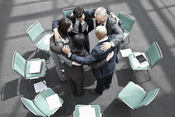 Mixed race group of business people in an informal team building meeting. - Stock Photo - Images